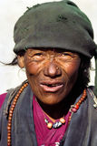Portrait old and poor man. Portrait of poor wrinkled man with worn out clothes in Tingri, rural Tibet Stock Photography