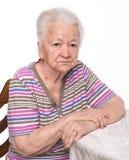 Portrait of old sad woman Stock Photo