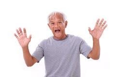 Portrait of old senior man with eye sickness, surfer's eye Stock Photos