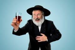 Portrait of old senior orthodox Hasdim Jewish man. With kosher wine at Jewish festival of Purim at studio. The purim, jewish, festival, holiday, celebration stock photography