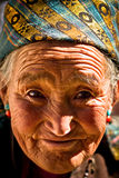Portrait of an old smiling woman from Tibet Royalty Free Stock Images
