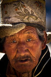 Portrait of an old traditional man from Tibet Royalty Free Stock Image