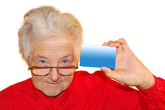 Portrait of old woman. In red with a card Royalty Free Stock Image