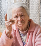 Portrait of  old woman in angry gesture Royalty Free Stock Photo