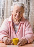 Portrait of old woman with cup of tea Royalty Free Stock Photo
