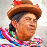 Quechua native old woman from Peru portrait. Portrait of an old woman from Cusco, Peru region. Quechua native, traditional colourful costume Stock Photos