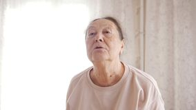A portrait of an old woman in the flat royalty free stock photo