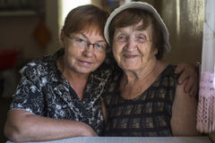Portrait of old woman and her daughter in the house. Love. Stock Image