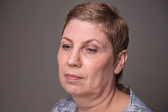 Portrait of old woman looking down Royalty Free Stock Images