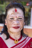 Portrait old woman with a pigmented spots on the face in the street. Pokhara, Nepal. POKHARA, NEPAL - OCTOBER 01, 2016 : Portrait old woman with a pigmented royalty free stock images