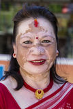 Portrait old woman with a pigmented spots on the face in the street. Pokhara, Nepal. POKHARA, NEPAL - OCTOBER 01, 2016 : Portrait old woman with a pigmented stock photography