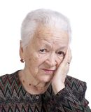 Portrait of old woman suffering from a headache Stock Images