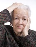 Portrait of old woman suffering from a headache Royalty Free Stock Images