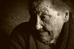 Portrait of an old woman. Toned portrait of an old woman with wrinkles Royalty Free Stock Photos