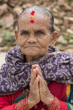 Portrait old woman in traditional dress with folded hands in street Kathmandu, Nepal Royalty Free Stock Photos