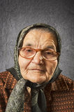 Portrait of an old woman on a vintage background. Royalty Free Stock Photos