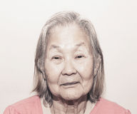 Portrait of a old woman with white hair Stock Image