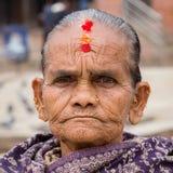 Portrait old women in traditional dress in street Kathmandu, Nepal Royalty Free Stock Images