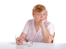 Portrait old women on a white Royalty Free Stock Image