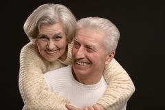 Portrait of older couple. Embracing on a black background Royalty Free Stock Images