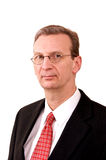 Portrait of older stern looking executive man on i Royalty Free Stock Photo