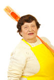 Portrait of older woman with broom Stock Image