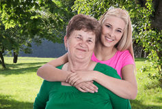 Portrait: older woman with her granddaughter or daughter in the Royalty Free Stock Photos