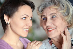 Portrait of an older woman and a young woman. Close-up portrait of a happy older women and a young woman Stock Photography
