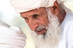 Portrait of an Omani man in a traditional Omani dress. Nizwa, Oman - 15/OCT/2016 Royalty Free Stock Images