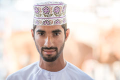 Portrait of an Omani man in a traditional Omani dress. Nizwa, Oman - 15/OCT/2016 Stock Images