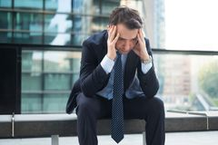Portrait of one depressed manager in trouble royalty free stock image