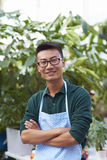 Portrait of One Happy Young Male Florist in Shop. One Young Happy Asian Male Florist Working in Shop Stock Images