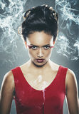 Mixed race woman holding burning incense stick Royalty Free Stock Images