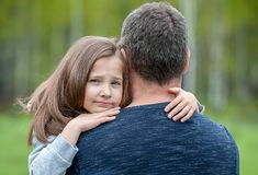 Portrait of one  sad daughter hugging her father. Portrait of one sad daughter hugging her father stock photography