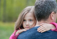 Portrait of one sad daughter   hugging her father. Portrait of one sad daughter hugging her father royalty free stock image