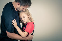 Portrait of one sad daughter hugging her father Royalty Free Stock Photo
