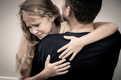 Portrait of one sad daughter hugging his father royalty free stock image