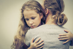 Portrait of one sad daughter hugging his mother Royalty Free Stock Image