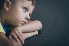 Portrait of one sad little boy. Concept of sorrow stock image