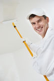 Happy house painter worker Stock Image