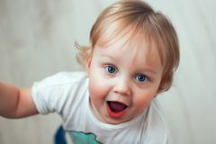 Portrait of a one year old beautiful surprised little boy with blue eyes and blond hair royalty free stock photography