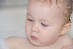 Portrait of one year old boy bathing Stock Photo