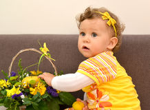 Portrait of the one-year-old girl with a flower basket Stock Images