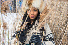 Portrait of one young woman in a meadow in winter stock photos