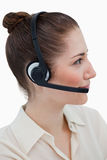 Portrait of an operator posing with a headset Royalty Free Stock Image