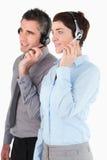 Portrait of operators using headsets Stock Photos