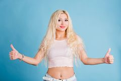 Beautiful blonde woman isolated light blue background royalty free stock photo
