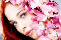 Portrait with orchid Stock Photo