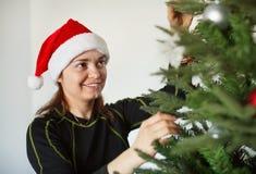 Portrait of ordinary girl near Christmas tree Royalty Free Stock Photography
