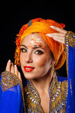 Portrait of oriental beauty in a turban and face art. Royalty Free Stock Photography